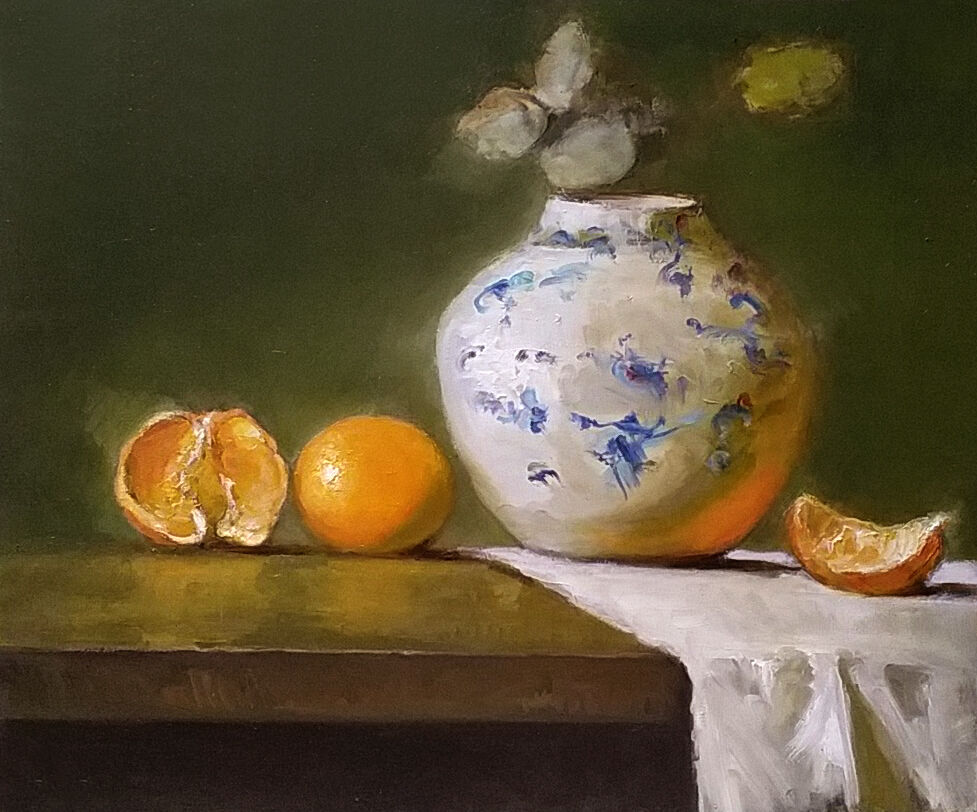 Still life with white and blue vase and oranges