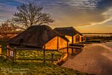 Golden glow on Boathouses at Hickling