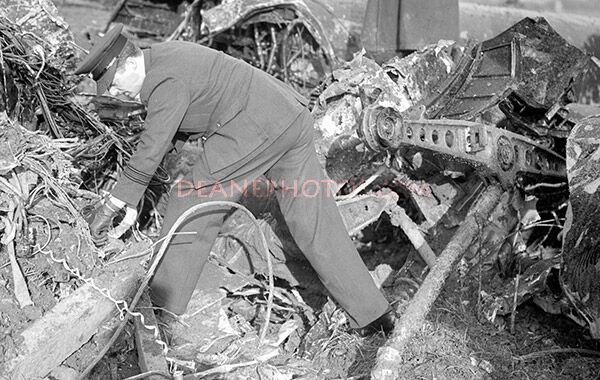 London Blitz Examining plane wreckage zoom
