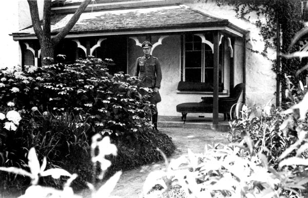 German Officer outside an unknown Guernsey House