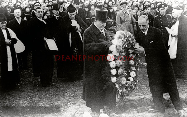 The Guernsey Baillif Mr Victor G Carey placing a wreath on behalf of the Island
