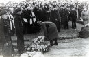 German soldier placing a wreath at the HMS Charybdis & HMS Limbourne Funeral