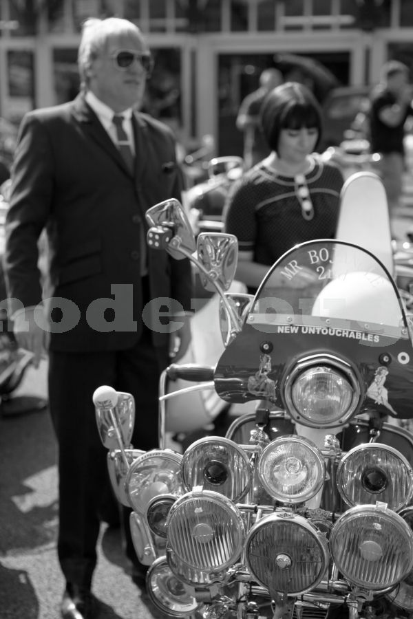 SUITED & SCOOTED
