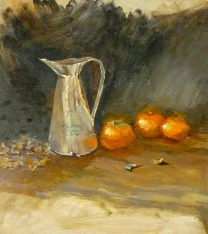 pitcher with oranges