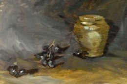 yellow vase with black grapes