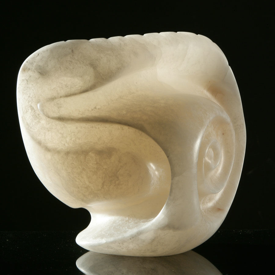 Handcarved in Alabaster. Inspired by the shapes, shells and stones found on a beach.
