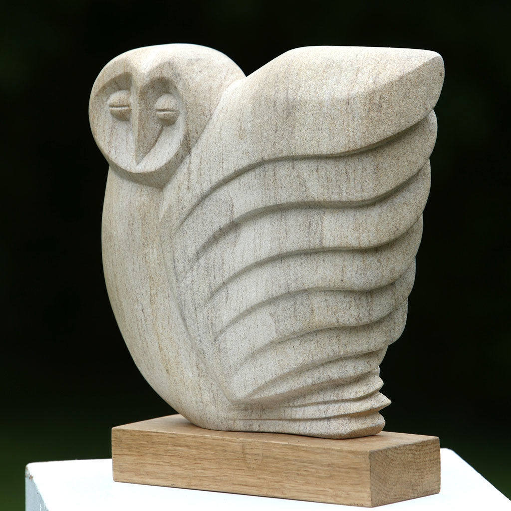 Hand carved in Ancaster Limestone on an Oak plinth