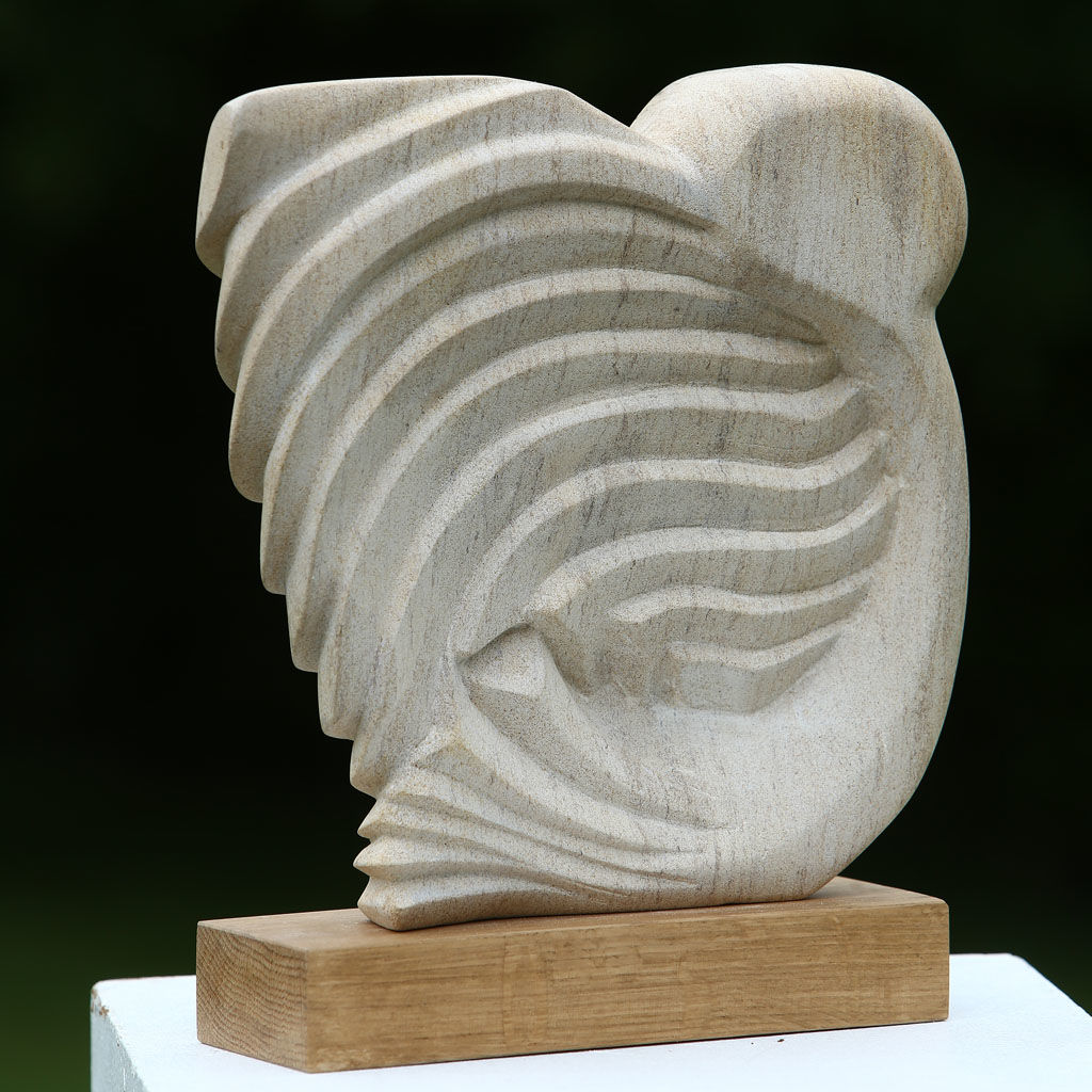 OWL Hand carved in Ancaster Limestone on an Oak plinth