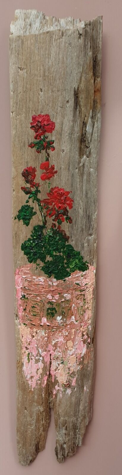 Red Geraniums on Driftwood
