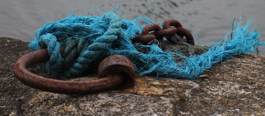 Rusty ring with blue rope