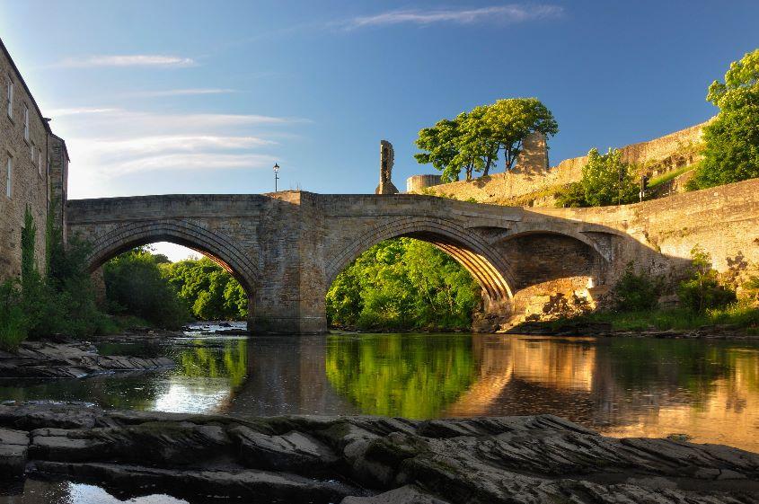 Water under castle bridge by James Mason