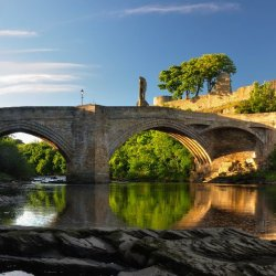 Water under castle bridge by James Mason