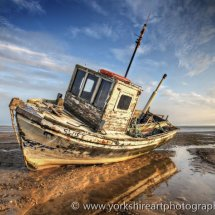 Fishing boat at low tide, Lythm, St Annes,  Lancashire, Uk