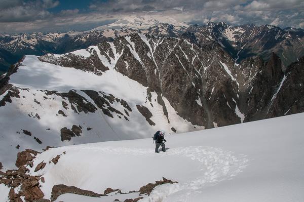 Climber on upper slopes of Kurmychi