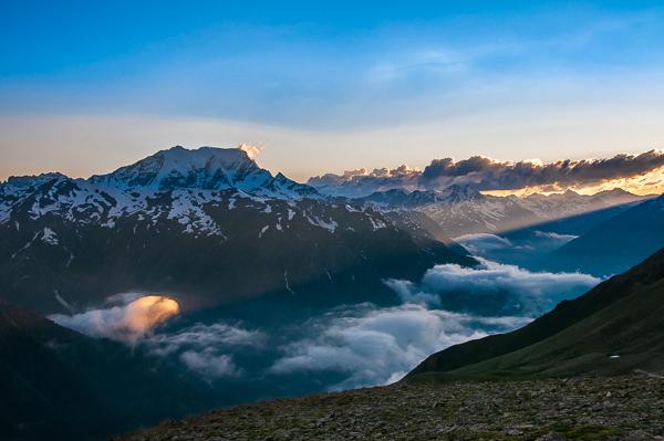 Beam of sunlight above Adyl Su Valley