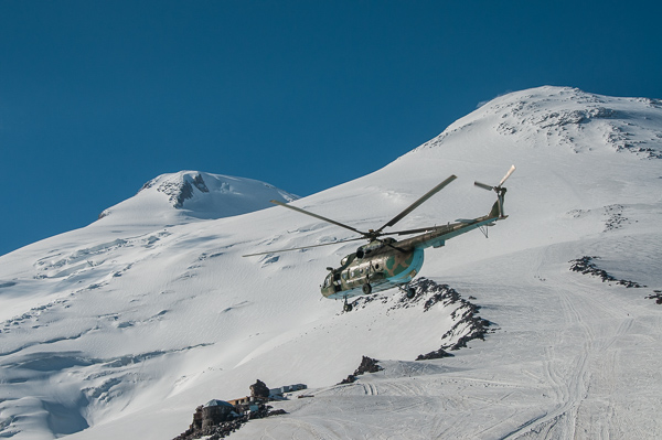 Russian Rescue Helicopter passing the Twin summits of Elbrus