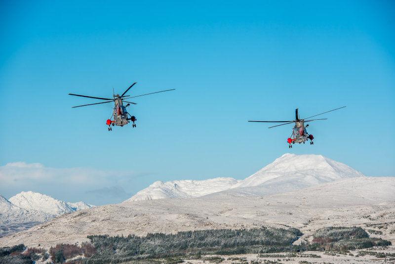 Rescue Sea Kings flying towards Ben Lomond