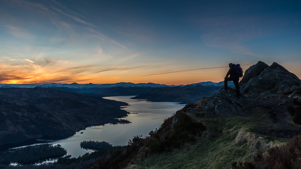 Walker on summit of Ben A'an at sunset