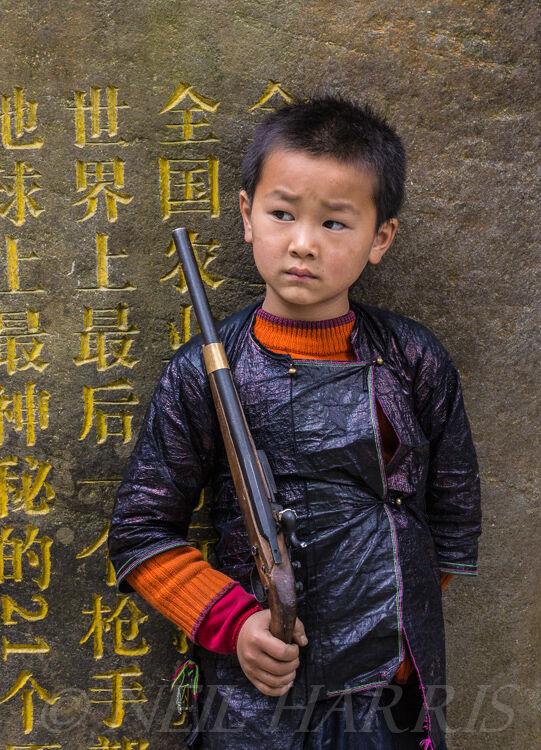 Basha - Boy with Pistol