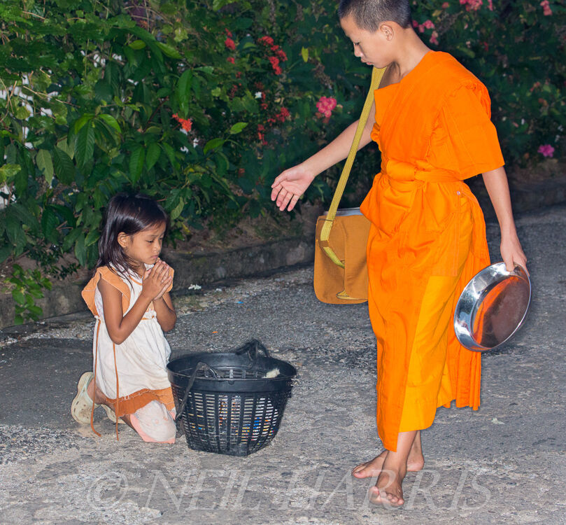 Novice giving alms