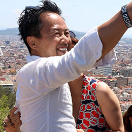 Tourists taking selfies at Park Guell, Barcelona, Spain.