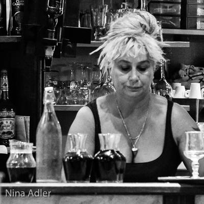 Woman behind the bar