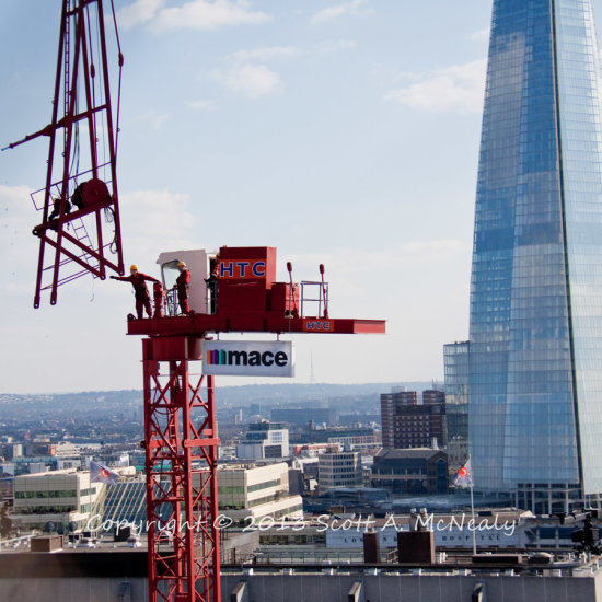 Monument View at top of assembly of a crane with Shard in background 2013