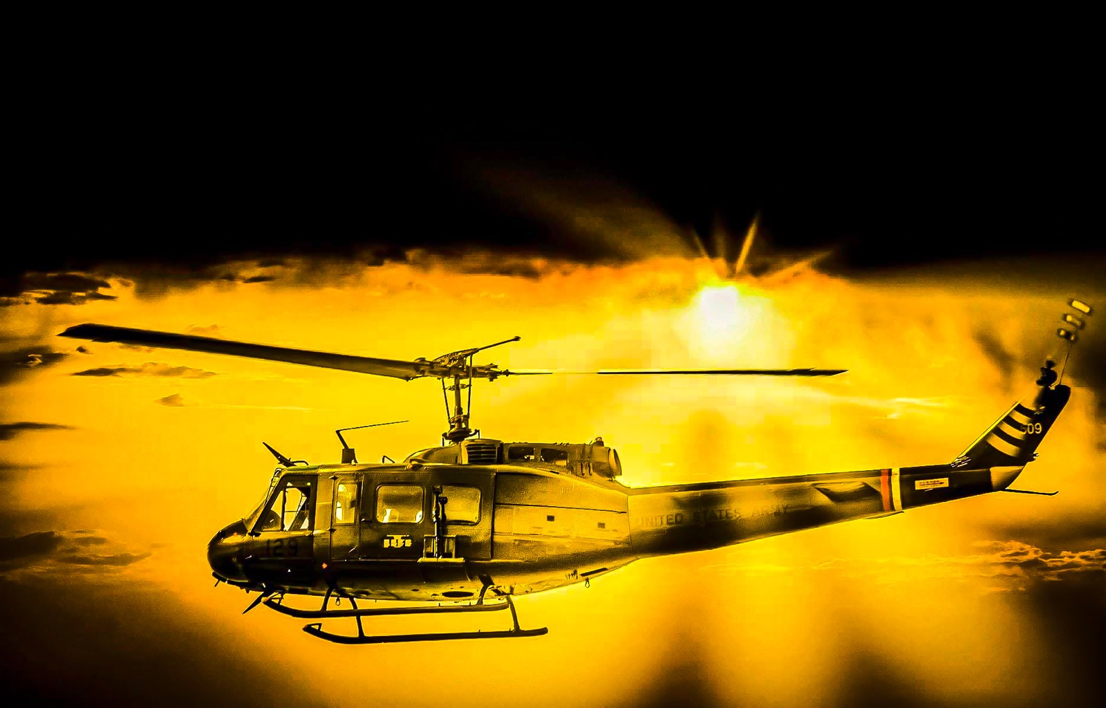 "Huey Helicopter agains the orange glow and sun rays  <a href= https://www.behance.net/cliffnorton "">latest Portfolio updates projects CliffNorton</a>