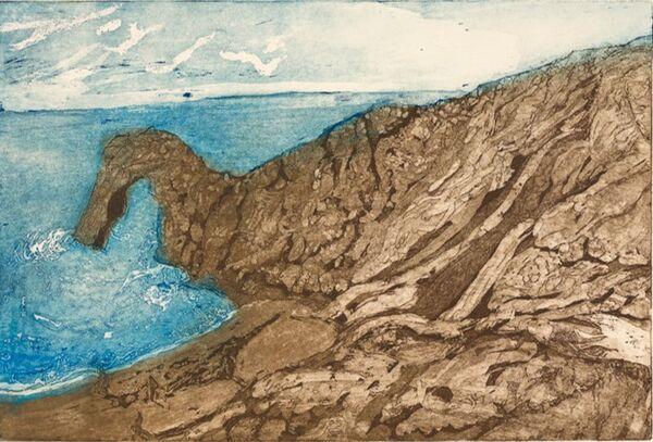 Durdle Door, a natural arch in a rich blue sea