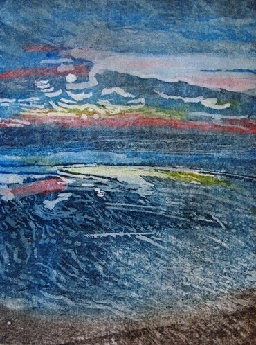 Looking out to sea at twilight with blues, reds and yellows. Almost abstract.