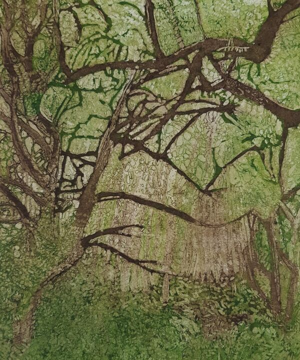 Tree branches against bright green filage