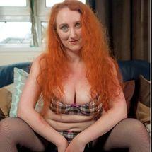 Serena Storm - Redhead cleavage