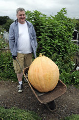 Man with enormous pumpkin