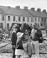 145 Paul Kavanagh with his children Conor, Graceanne and Paula after a riot in The Bogside in Derry 1969