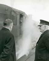 20 Station Master Tony Ryan with Peter Mc Ardle watching last steam train leaving Dundalk.