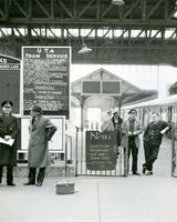24 Derry Station on occasion of last train from Dundalk to Derry. Gda. Det. Edward Kavanagh in felt hat and coat.