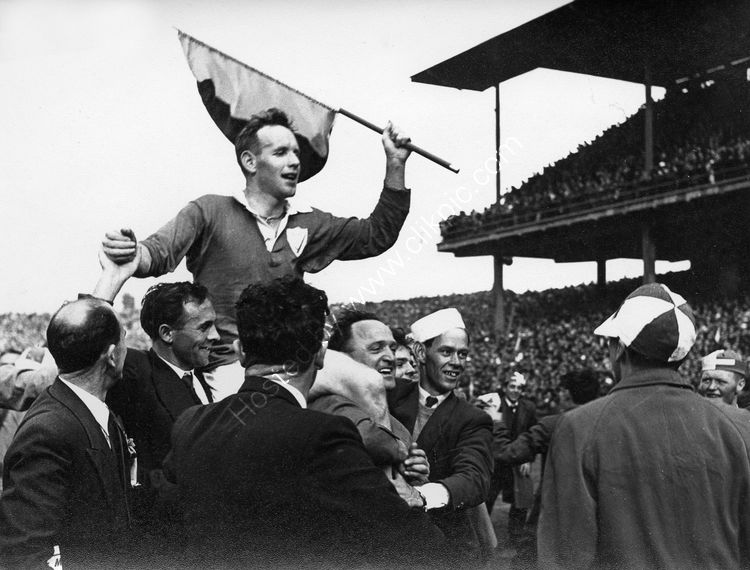 25 Louth win the All Ireland in 1957 Stephen White being carried off the pitch