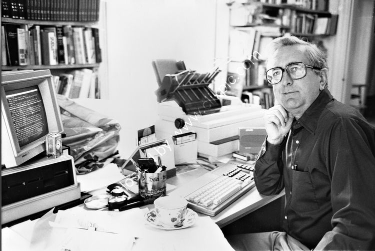 54 Crime Writer Len Deighton at his desk in Blackrock