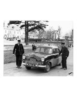 65 Gardai with one of the first official patrol cars a Ford Zephyr at teh Crescent Station Dundalk