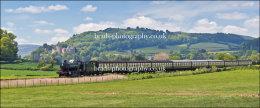 Steam train  passing Dunster Castle
