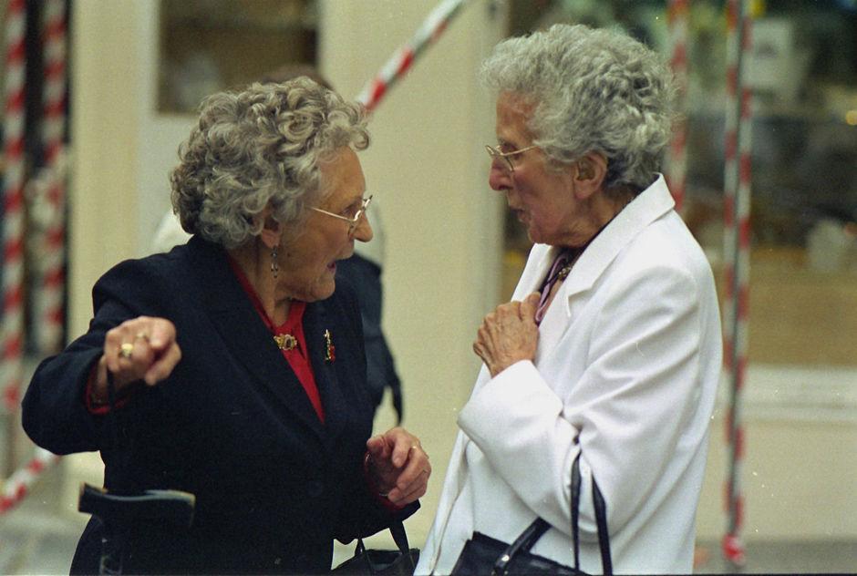 Two women chatting, Abbey Church Yard 2006