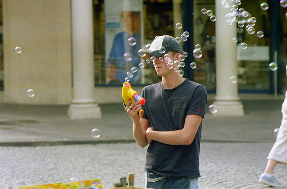 young man with bubble gun, Bath Street, 2004