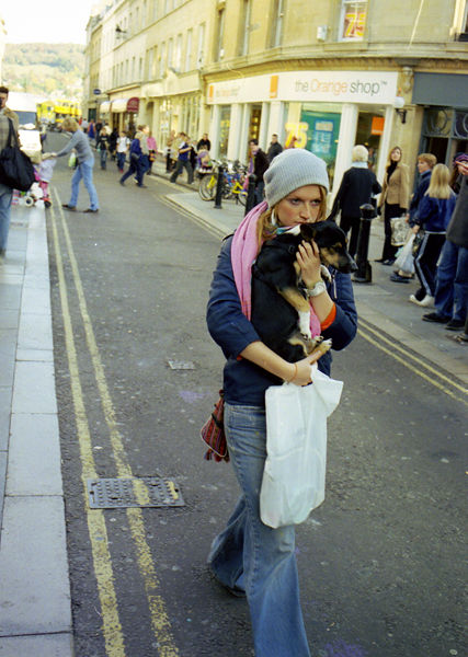 Young woman carrying a dog, Westgate Street, 2003