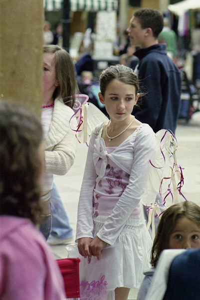 Young girl wearing wings, Stall Street, 2006