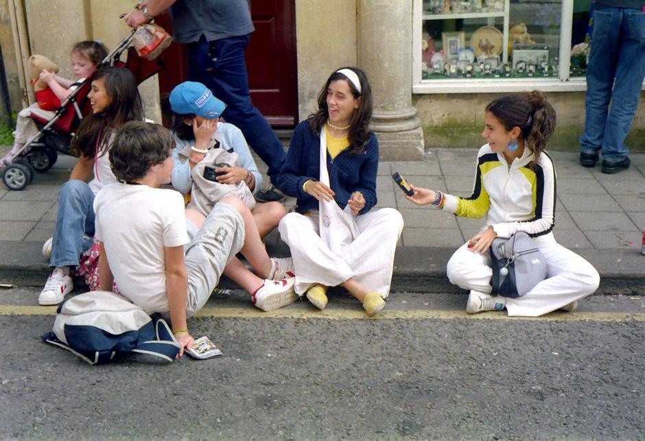 Children squat the pavement, Westgate Street, 2003