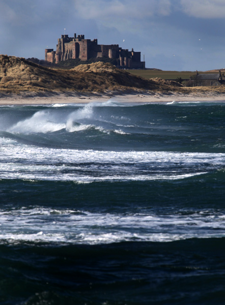 Bamburgh from Seahouses Harbour
