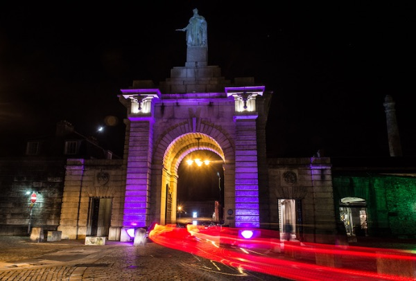 Night time image of the main entrance to the Plymouth's Royal William Yard.