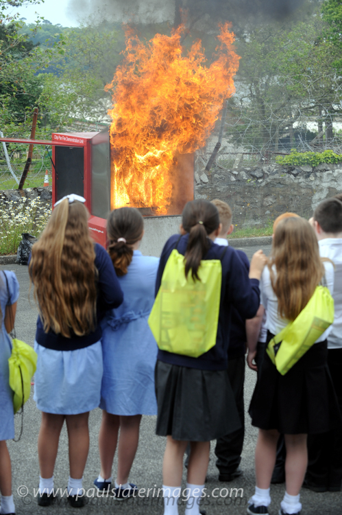 Chip pan fire demonstration to Plymouth school pupils by Devon and Cornwall Fire Service.