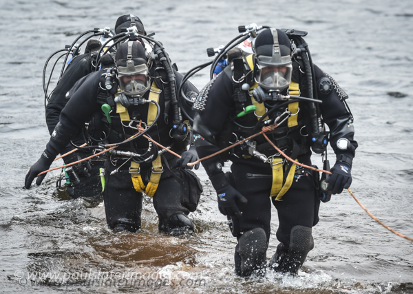 Specialist Police diver unit searching for a missing person on Dartmoor, Devon.