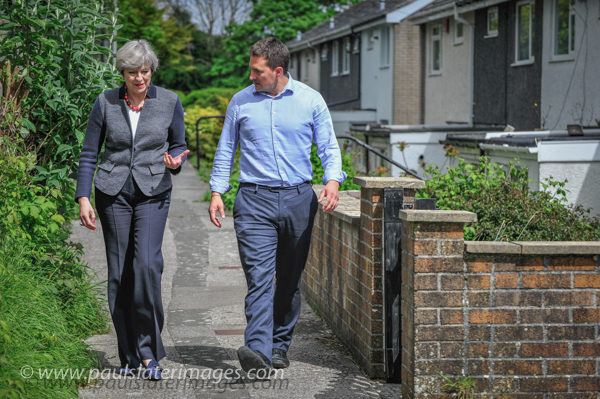 Prime Minister Theresa May pictured with Plymouth Moore View MP Johnny Mercer during a private visit to a military family in the city.